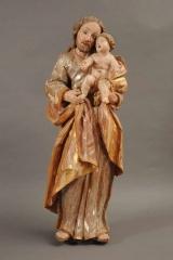 <h5>Saint Joseph</h5><p>non signé, 88 (hauteur totale) x 31.5 (largeur), bois sculpté, polychromé, doré et argenté</p>